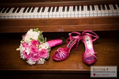 Gorgeaos pink shoes and a beautiful bridal bouquet with pink roses near a piano