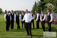 A groom and groomsmen posing casually with golf clubs at Deer Creek Golf Club