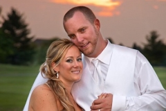 Classic Traditional portrait of a wedding couple in the sunset on the golf course