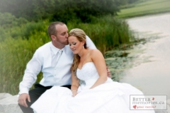 Couple share a romantic moment by the pond at Deer Creek Wedding
