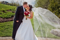 Bride and Groom kissing by the Deer Creek Golf Course