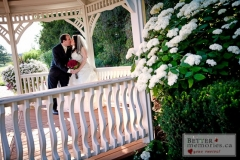 Bride and Groom kissing in the gazebo at Deer Creek Golf Club