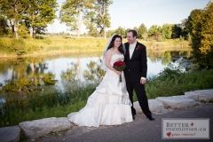 Bride and Groom standing by the pond at Deer Creek Golf Club