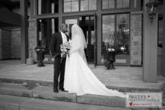 Bride and Groom kissing on the steps of the Deer Creek Golf Club House