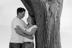 Engaged couple together by a tree at Lakeview Park and the Jubilee Pavilion