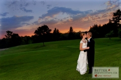 Bride and groom kissing on the Kedron Dells Golf Course at sunset