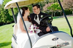 Bride and groom in a golf cart on the Kedron Dells golf course