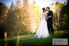 Bride and groom kissing on the Kedron Dells Golf Course