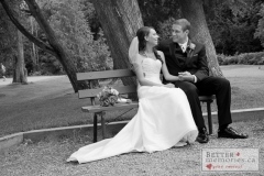 Bride and Groom sitting together on a bench at the Kedron Dells Golf Course