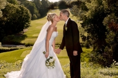 Bride and Groom kissing on the Oshawa Golf Club Course