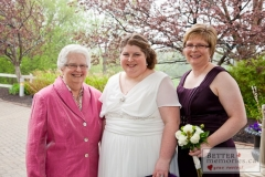 Bride outdoors with her Maid of Honour and Mother