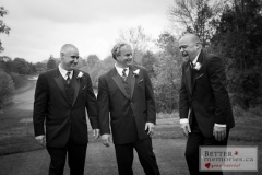 Groom and groomsmen having a laugh one the golf course at Oshawa Golf Club