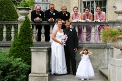 Bridal Party and flower girl on the steps at Parkwood Estate