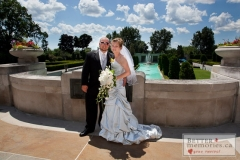 Bride and Groom outside by the fountain at Parkwood