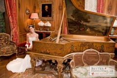 Bride sitting by the grand piano inside a room at Parkwood Estate