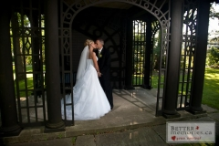 Newlyweds kissing in the gazebo