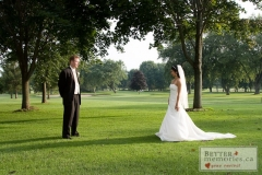 Bride and Groom looking at each other on the golf course