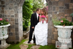 Bride and Groom outside by a stone walkway