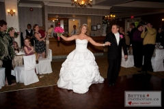 Bride and Groom stepping onto the dance floor for their first dance