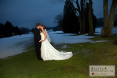 Bride and Groom kissing at dusk on the golf course in the winter