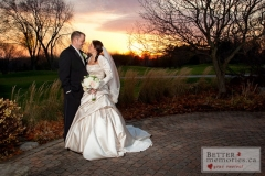 Bride and Groom on a pathway outside at sunsest