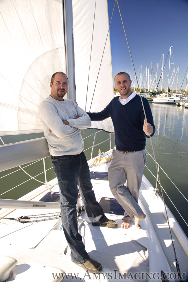 A casual portrait of two brothers on a sailboat