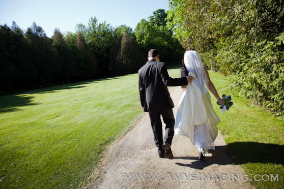 Scenic shot of bride and groom walking holding hands
