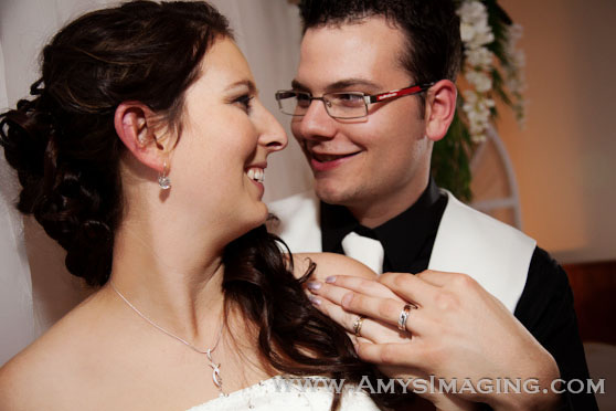 Wedding ring shot with bride and groom